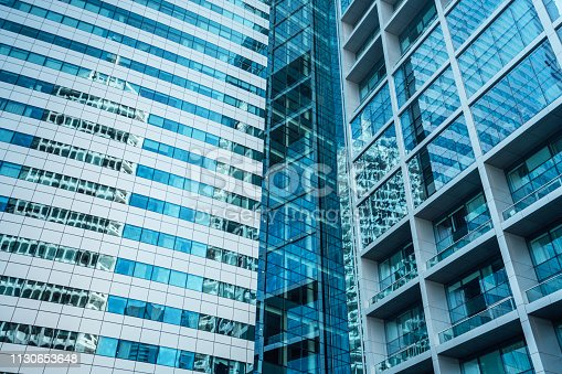 istock Buildings reflected in windows of modern office building 1130653648