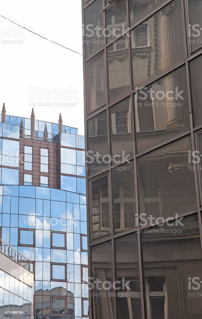 Buildings reflected in windows of modern office building stock photo