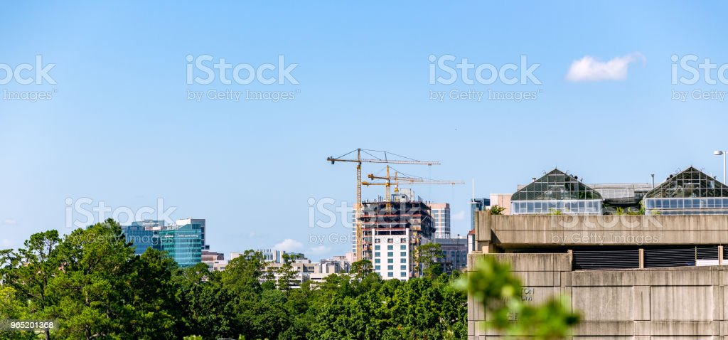 Buildings with cranes zbiór zdjęć royalty-free