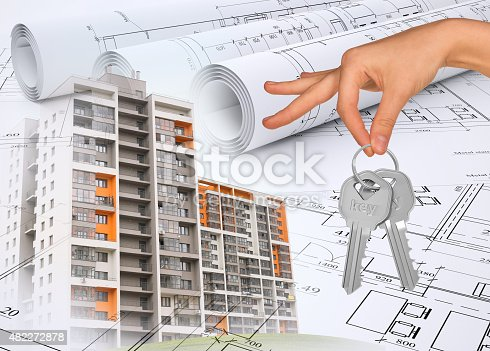 istock Buildings with hand holding keys and drafts 482272878
