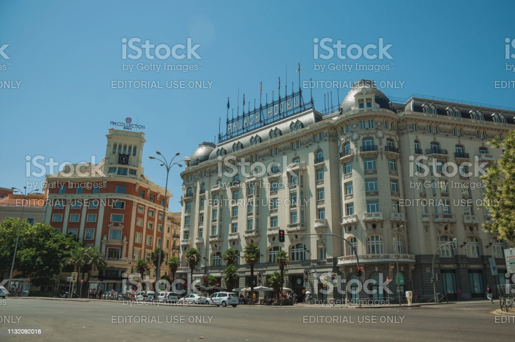 Madrid, Spain - July 25, 2018. Old buildings with hotel on busy...