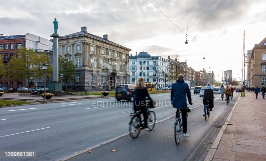 Copenhagen, Denmark - Oct 18, 2018: Buildings with ornate classical European architectural designs along the famous Hans Christian Andersen Boulevard. Vehicles, cyclists and pedestrians around.