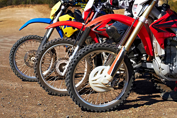 Built for tough terrain Three dirt bikes standing in a row three wheel motorcycle stock pictures, royalty-free photos & images