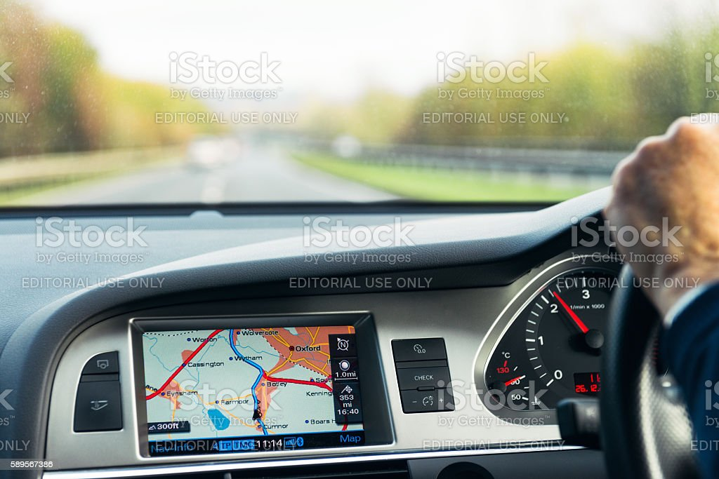 Built-in Audi satellite navigation in use on UK road bildbanksfoto