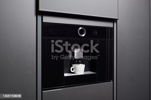 istock Built-in coffee machine in contemporary kitchen 1305159638