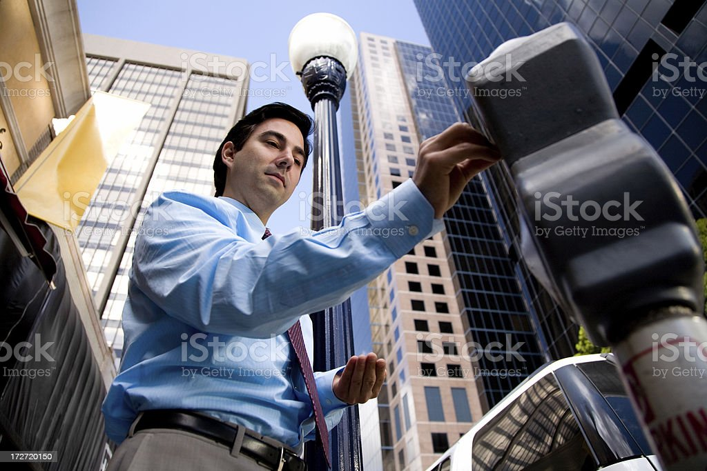 Buinessman Feeds Parking Meter royalty-free stock photo