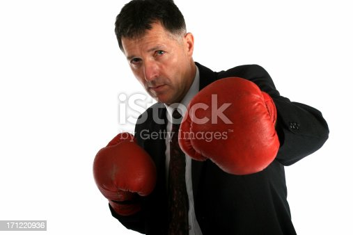 Buisness man with boxing gloves ready to fight all problems he will find