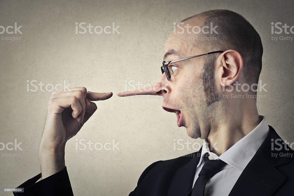 Buisnessman telling lies foto de stock libre de derechos
