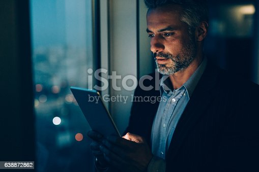 istock Buisnessman Using Tablet At Night 638872862