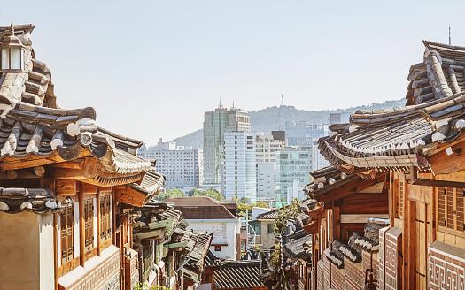 Bukchon Hanok Village Houses and Roofs. View to downtown Seoul Skyline and N Seoul Tower.  Historic Bukchon Hanok Neighborhood of Seoul South Korea, Asia.