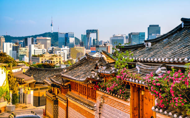 Bukchon Hanok Village with modern building in Seoul, South Korea stock photo