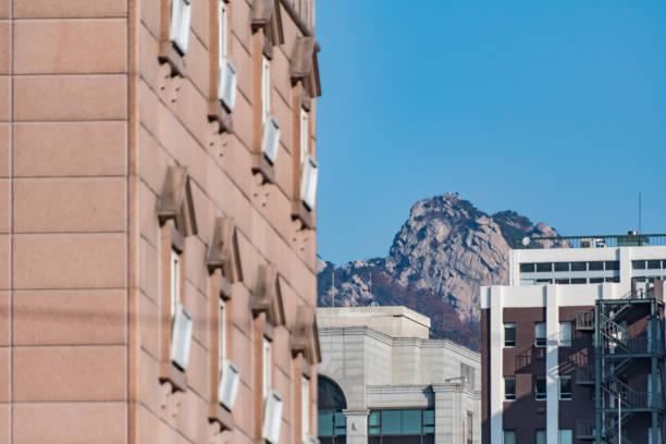 Bukhansan Mountains behind buildings in Seoul, South Korea stock photo