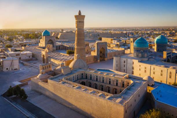 Bukhara Sunset Poi Kalon Minaret Mir Arab Madrasah in Uzbekistan stock photo