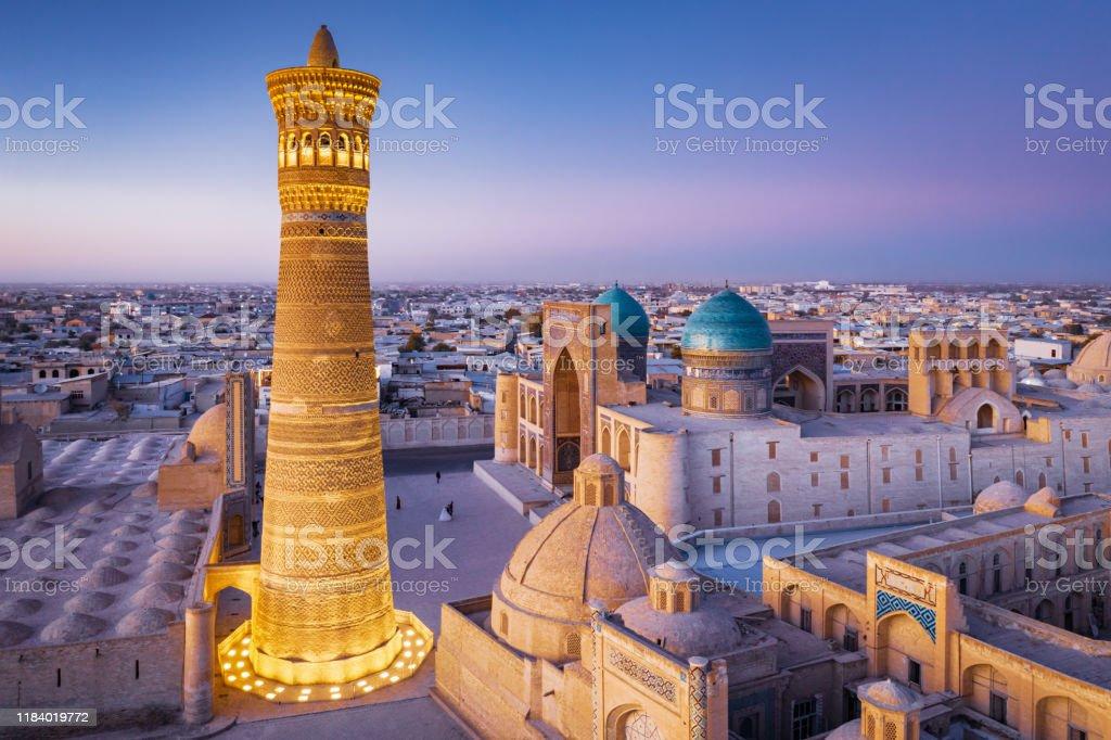 Bukhara Uzbekistan Kalyan Minaret and Madressa Sunset Twilight - Royalty-free Aerial View Stock Photo