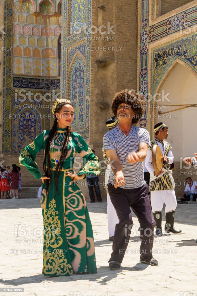 Bukharian Musicians In Local Dress Dance In Bukhara