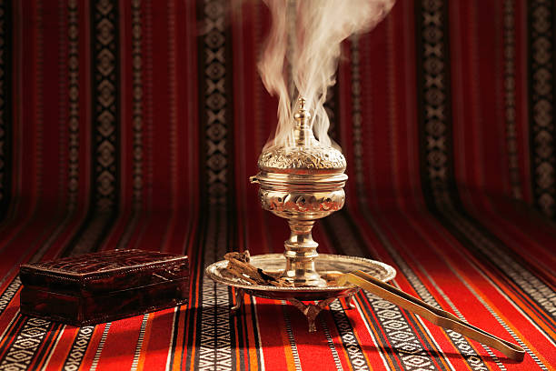 Bukhoor burned in a mabkhara in many Arab countries Bukhoor is usually burned in a mabkhara, a traditional incense burner It is customary in many Arab countries to pass bukhoor amongst the guests in the majlis incense stock pictures, royalty-free photos & images