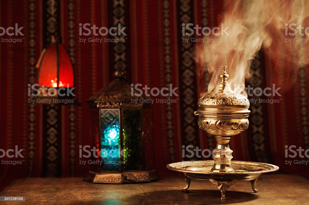 Bukhoor burned in a mabkhara in many Arab countries stock photo