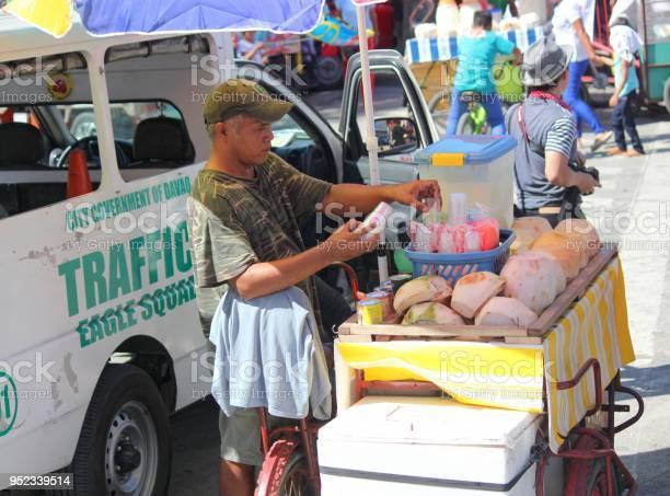 Buko vendor in the street philippines picture id952339514?b=1&k=6&m=952339514&s=612x612&h=rdpsugw4xdsqahol40x6lehzb294eiq0en80khbqn0k=