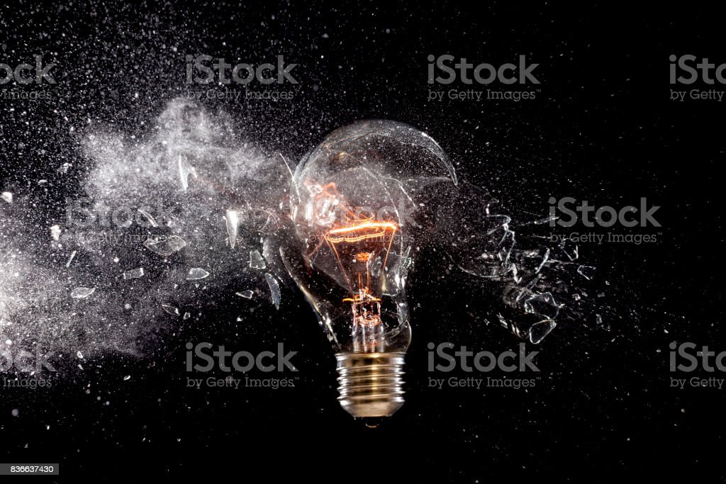 bulb glass explosion stock photo