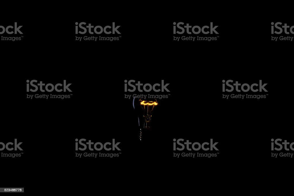 Bulb in darkness stock photo