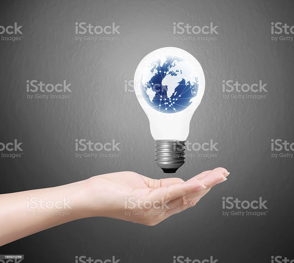 bulb light on a hand royalty-free stock photo