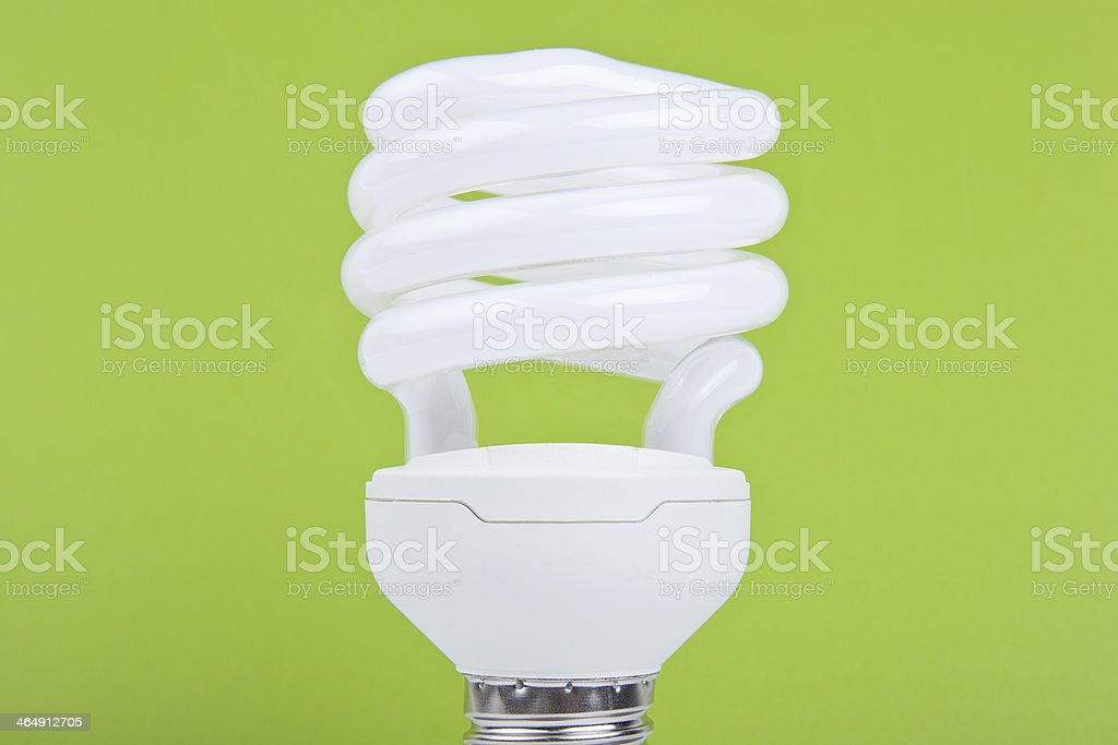 bulb on green background stock photo