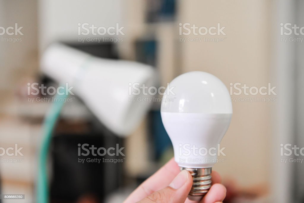 LED bulb - Selected the bulb to use with electric lamp, Changing the bulb to LED bulb to use for lamp for saving the energy stock photo