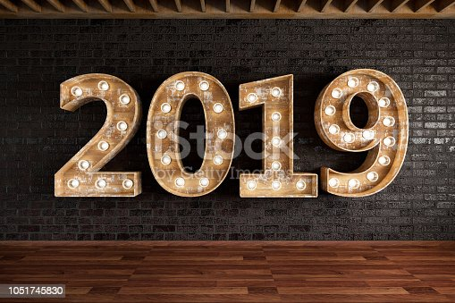 istock 2019 Bulb Sign On Black Brick Wall 1051745830
