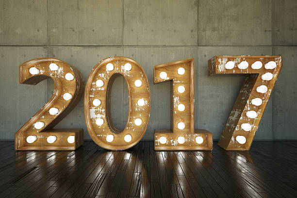 2017 Bulb Sign Lightbulb sign with 2017 against concrete wall 2017 stock pictures, royalty-free photos & images