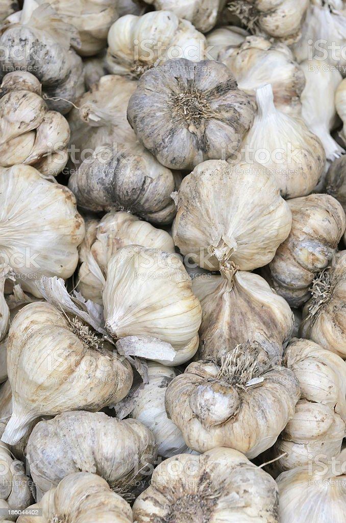 Bulbs of garlic on display at farmer's market royalty-free stock photo