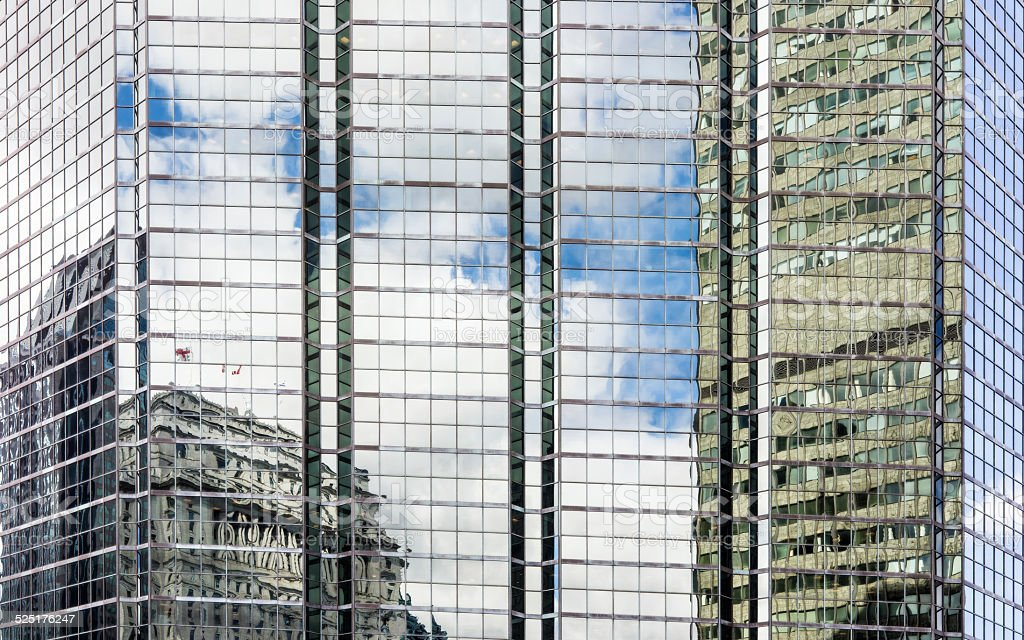 Bulding reflections on glass windows stock photo