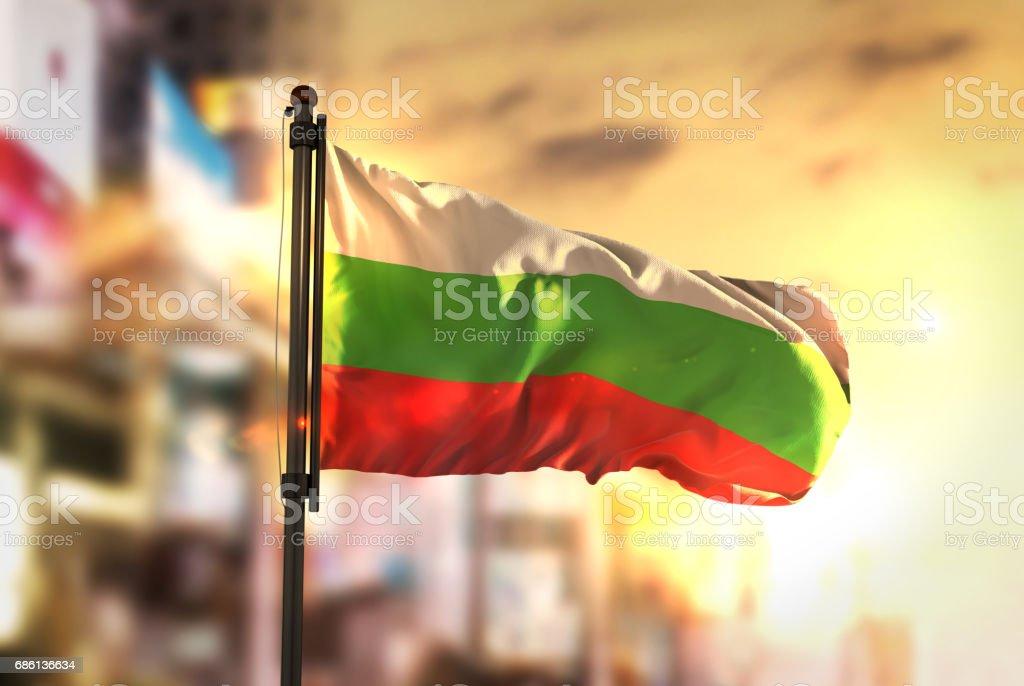 Bulgaria Flag Against City Blurred Background At Sunrise Backlight stock photo