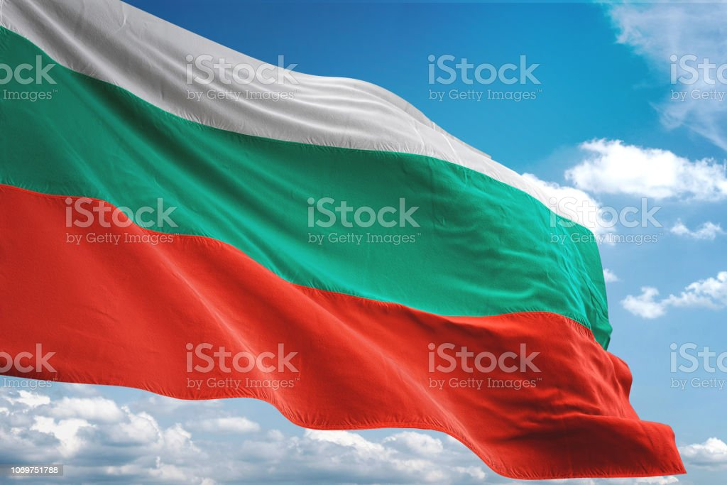 Bulgaria flag waving cloudy sky background stock photo