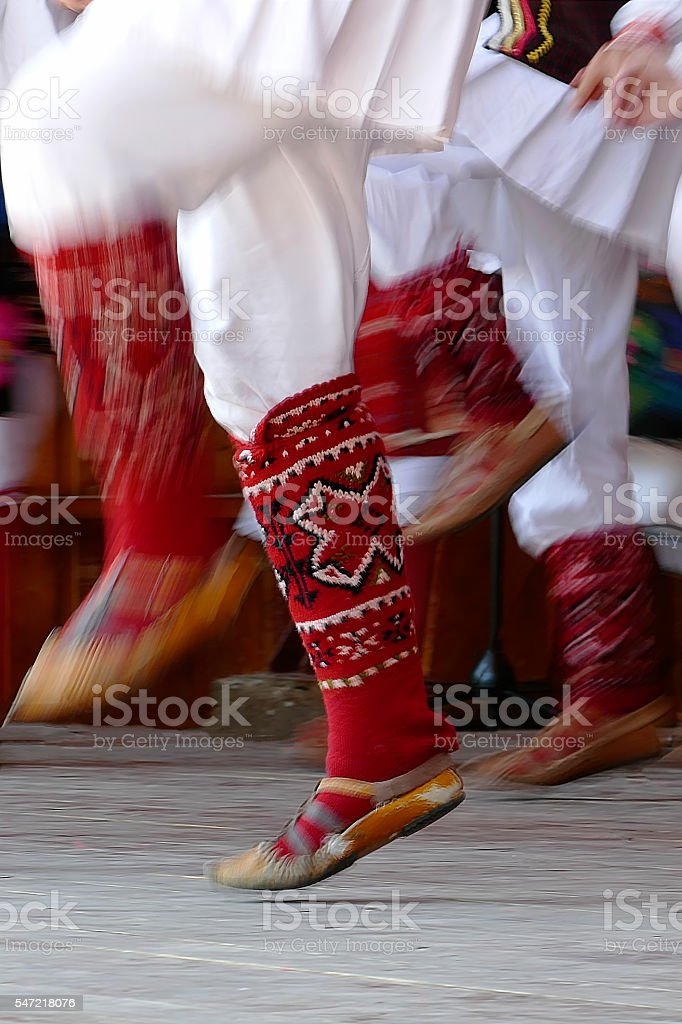 Bulgarian dancers legs in a traditional dance stock photo