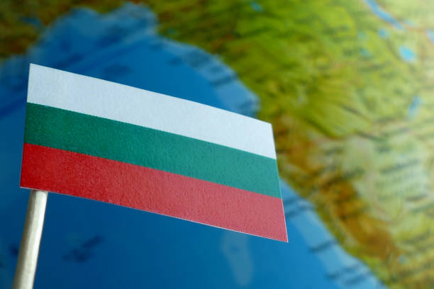 Bulgarian flag with a globe map as a background macro stock photo