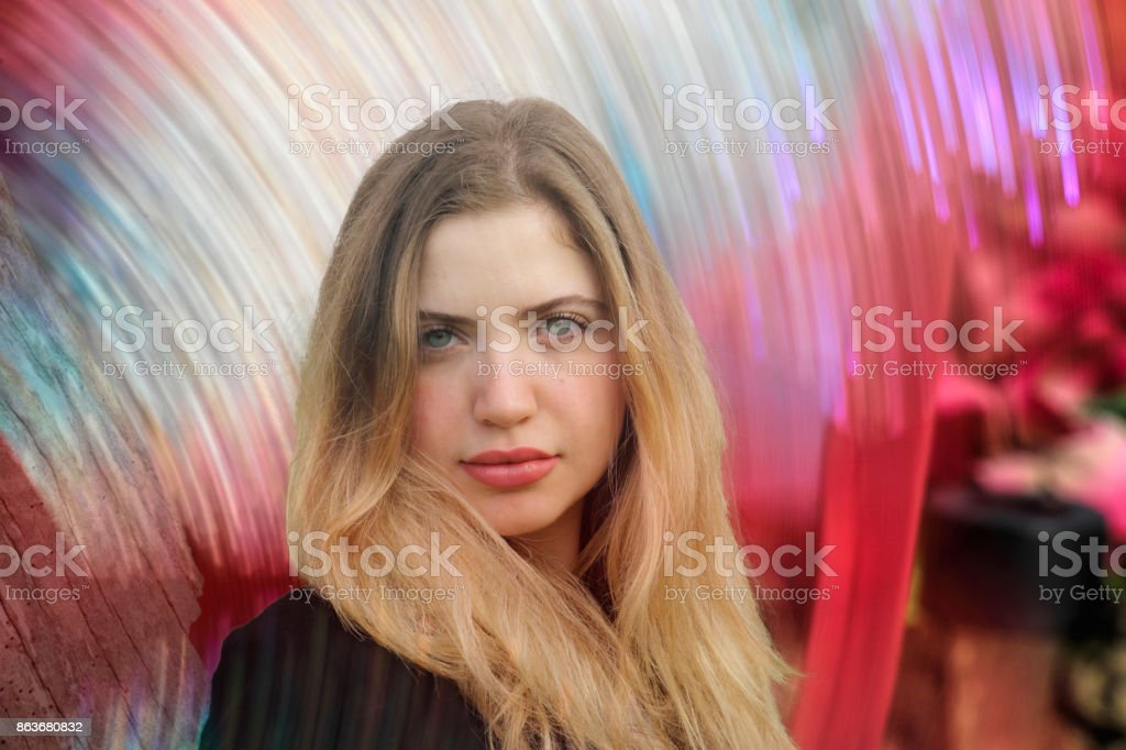 Bulgarian outdoor girl leaning on trunk of dead tree abstract stock photo
