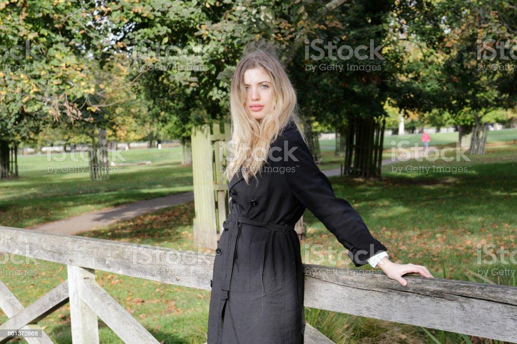 Bulgarian outdoor girl leaning on wooden bridge stock photo