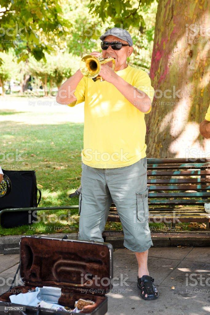 Bulgarian Street Musician Playing Trumpet stock photo