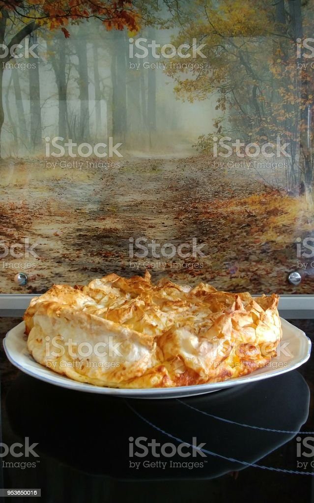 Bulgarian traditional eating called banitsa in my kitchen. stock photo
