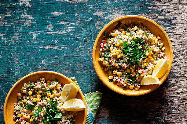 bulgur and vegetables salad - quinoa stock photos and pictures