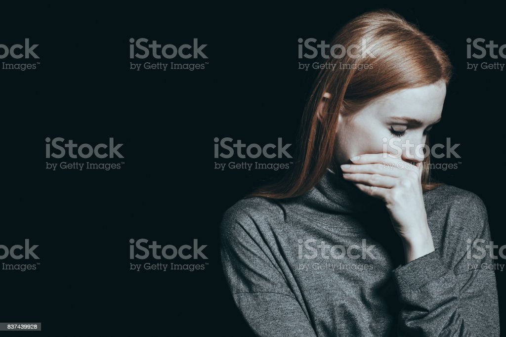 Bulimic woman covering her mouth - Royalty-free Addiction Stock Photo