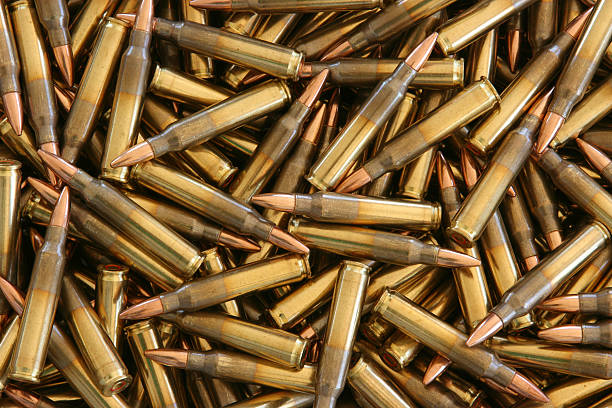 "Bulk 5.56 x 45mm NATO Ammo ""5.56mm Ammunition in bulk, close up."" ammunition stock pictures, royalty-free photos & images"