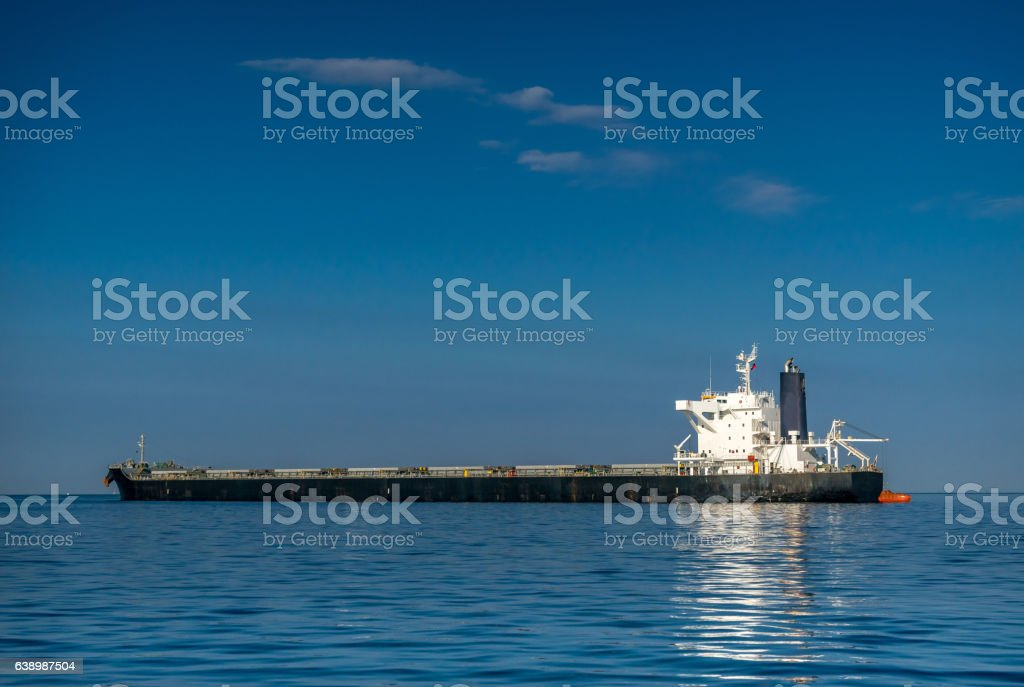 Bulk carrier and lifeboat stock photo