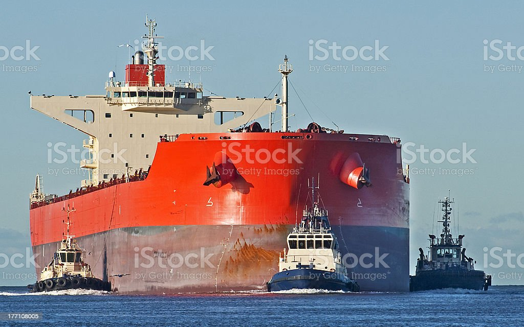 Bulk Carrier and Tugs stock photo