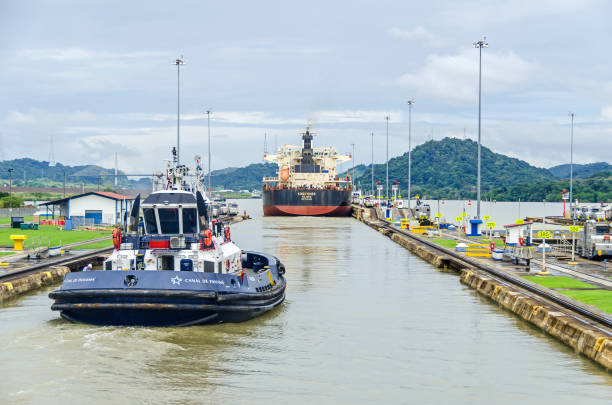 Bulk Carrier KINGFISHER exiting the Miraflores Locks Panama City, Panama - 4 November, 2017: Bulk Carrier KINGFISHER just passed through the Miraflores Locks with the help of a tugboat and electric locomotives or mules exiting the locks into the Miraflores Lake of Panama Canal. deadweight stock pictures, royalty-free photos & images