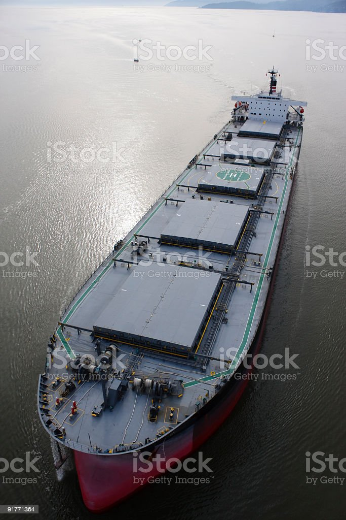 Large bulk carrier traveling forward, directly below.