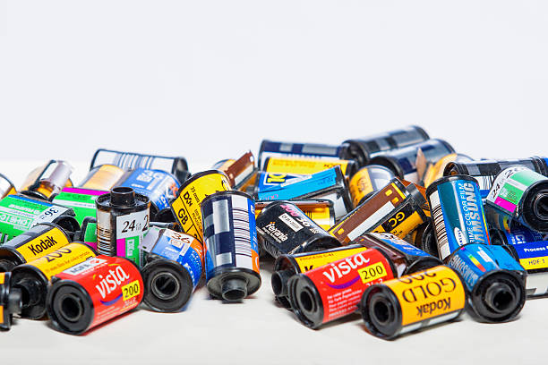 bulk variety of old photo films cassettes - fuji sofortbildkamera stock-fotos und bilder