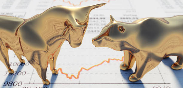 Bull and Bear on financial Newspaper Close up of golden Bull and Bear standing on a Stock Market Newspaper bull market stock pictures, royalty-free photos & images