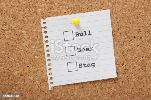 Tick Boxes for Bull, Bear and Stag on a piece of paper pinned to a cork notice board. These are names used to describe Stock Market traders based on their buying and selling tactics.