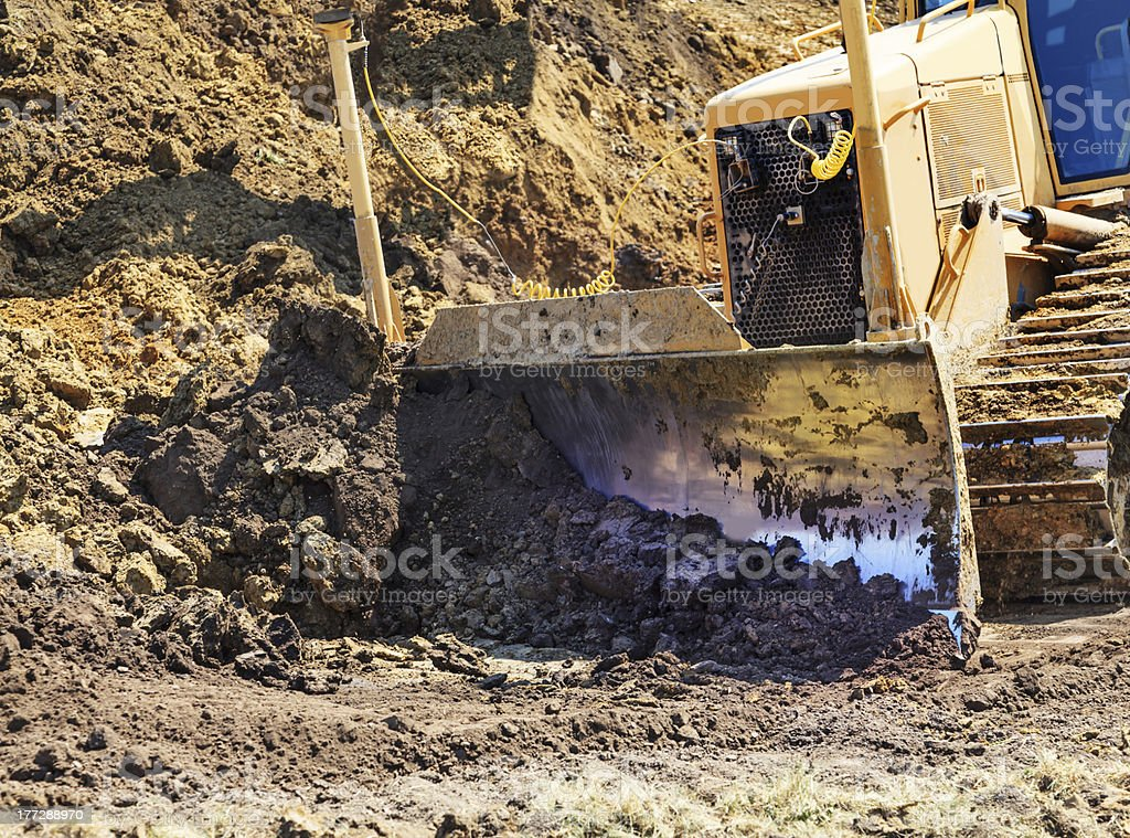 Bull dozer moving dirt royalty-free stock photo